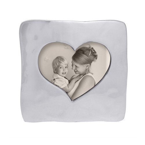 The soft texture of this Large Square Open Heart Frame allows a photo of you and a loved one to peek through, in a heartfelt way. Included in our Lets Celebrate collection, this handcrafted frame revels in eternal romance. Recycled Sandcast Aluminum DETAILS & PRODUCT CARE Dimensions: 7.91in L x 1in W x 7.91in H Product Care: Our fine metal is handcrafted from 100% recycled aluminum. All items are food-safe and will not tarnish. Handwash in warm water with mild soap and towel dry immediately. Do not place in dishwasher or microwave. Avoid extended contact with water, salty or acidic foods; coat lightly with vegetable oil or spray to easily avoid staining. Warm to 350 degerees for hot foods. Freeze or chill for summer entertaining. Cutting directly on the metal surface will scratch the finish. Occasional use of non-abrasive metal polish will revive luster.