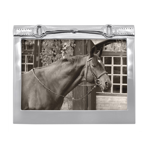Horse Bit 5x7 Frame Recycled Sandcast Aluminum DETAILS & PRODUCT CARE Item Code: 2251 Dimensions: 7.64in L x 6.46in W x 1.00in H Product Care: Our fine metal is handcrafted from 100% recycled aluminum. All items are food-safe and will not tarnish. Handwash in warm water with mild soap and towel dry immediately. Do not place in dishwasher or microwave. Avoid extended contact with water, salty or acidic foods; coat lightly with vegetable oil or spray to easily avoid staining. Warm to 350 degerees for hot foods. Freeze or chill for summer entertaining. Cutting directly on the metal surface will scratch the finish. Occasional use of non-abrasive metal polish will revive luster.