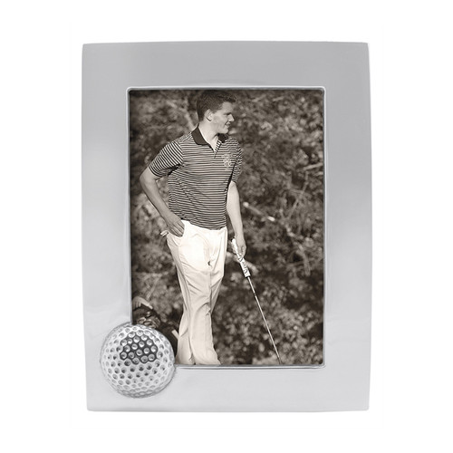 Golf Ball 5x7 Frame Recycled Sandcast Aluminum DETAILS & PRODUCT CARE Item Code: 2706 Dimensions: 8.66in L x 6.69in W x 1.42in H Product Care: Our fine metal is handcrafted from 100% recycled aluminum. All items are food-safe and will not tarnish. Handwash in warm water with mild soap and towel dry immediately. Do not place in dishwasher or microwave. Avoid extended contact with water, salty or acidic foods; coat lightly with vegetable oil or spray to easily avoid staining. Warm to 350 degerees for hot foods. Freeze or chill for summer entertaining. Cutting directly on the metal surface will scratch the finish. Occasional use of non-abrasive metal polish will revive luster.