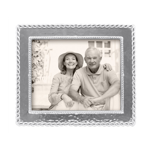 Our luxe Meridian 8 x 10 Frame evokes style and gives a fresh, sophisticated look to a cherished photograph. Recycled Sandcast Aluminum DETAILS & PRODUCT CARE Dimensions: 12.5in L x 10.75in W Product Care: Our fine metal is handcrafted from 100% recycled aluminum. All items are food-safe and will not tarnish. Handwash in warm water with mild soap and towel dry immediately. Do not place in dishwasher or microwave. Avoid extended contact with water, salty or acidic foods; coat lightly with vegetable oil or spray to easily avoid staining. Warm to 350 degerees for hot foods. Freeze or chill for summer entertaining. Cutting directly on the metal surface will scratch the finish. Occasional use of non-abrasive metal polish will revive luster.