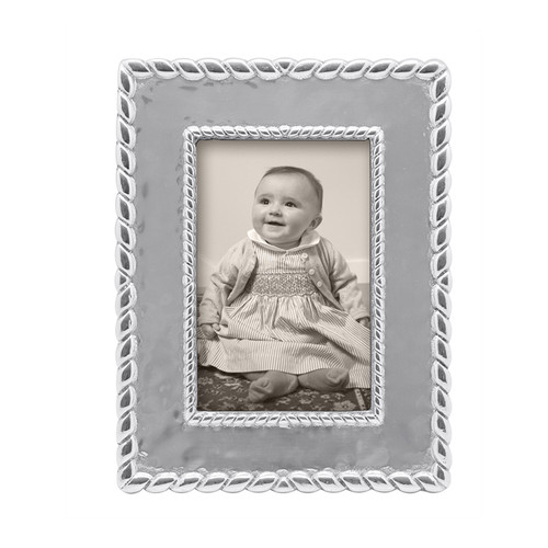 Our luxe Meridian 4 x 6 Frame evokes style and gives a fresh, sophisticated look to your favorite photograph. Recycled Sandcast Aluminum DETAILS & PRODUCT CARE Dimensions: 8.75in L x 6.75in W Product Care: Our fine metal is handcrafted from 100% recycled aluminum. All items are food-safe and will not tarnish. Handwash in warm water with mild soap and towel dry immediately. Do not place in dishwasher or microwave. Avoid extended contact with water, salty or acidic foods; coat lightly with vegetable oil or spray to easily avoid staining. Warm to 350 degerees for hot foods. Freeze or chill for summer entertaining. Cutting directly on the metal surface will scratch the finish. Occasional use of non-abrasive metal polish will revive luster.
