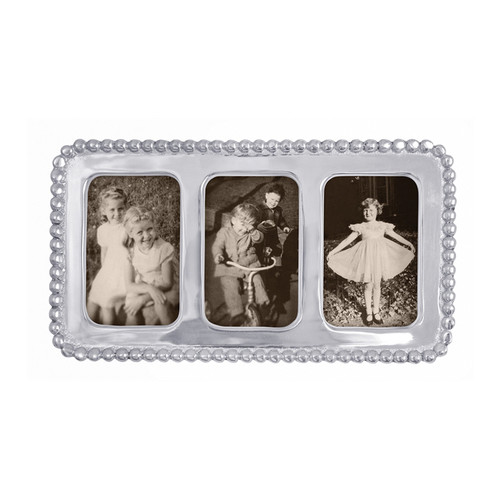 Frame three of your favorite memories, perhaps from school picture day, or beyond in our Beaded Collage Frame. Part of our signature String of Pearls collection. Recycled Sandcast Aluminum DETAILS & PRODUCT CARE Dimensions: 7.25in L x 4in W Product Care: Our fine metal is handcrafted from 100% recycled aluminum. All items are food-safe and will not tarnish. Handwash in warm water with mild soap and towel dry immediately. Do not place in dishwasher or microwave. Avoid extended contact with water, salty or acidic foods; coat lightly with vegetable oil or spray to easily avoid staining. Warm to 350 degerees for hot foods. Freeze or chill for summer entertaining. Cutting directly on the metal surface will scratch the finish. Occasional use of non-abrasive metal polish will revive luster. Photo Opening Size: 2 x 3