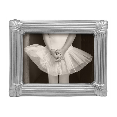 With heirloom warmth, our Linear Leaf 5x7 Frame features a sophisticated linear pattern with elegant leaf details in each corner. Handcrafted from 100% recycled aluminum. Recycled Sandcast Aluminum DETAILS & PRODUCT CARE Dimensions: 9in L x 7in H Product Care: Our fine metal is handcrafted from 100% recycled aluminum. All items are food-safe and will not tarnish. Handwash in warm water with mild soap and towel dry immediately. Do not place in dishwasher or microwave. Avoid extended contact with water, salty or acidic foods; coat lightly with vegetable oil or spray to easily avoid staining. Warm to 350 degerees for hot foods. Freeze or chill for summer entertaining. Cutting directly on the metal surface will scratch the finish. Occasional use of non-abrasive metal polish will revive luster.