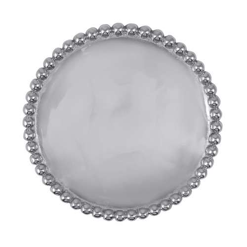 We have a gift for tradition, reimagined, in our String of Pearls collection. A multitude of pearls provide a luxurious border around the polished, silver interior of the our Pearled Trivet. This piece decorates your table and can take the heat of bakeware straight from the oven--a winning combination! Recycled Sandcast Aluminum DETAILS & PRODUCT CARE Product Care: Our fine metal is handcrafted from 100% recycled aluminum. All items are food-safe and will not tarnish. Handwash in warm water with mild soap and towel dry immediately. Do not place in dishwasher or microwave. Avoid extended contact with water, salty or acidic foods; coat lightly with vegetable oil or spray to easily avoid staining. Warm to 350 degerees for hot foods. Freeze or chill for summer entertaining. Cutting directly on the metal surface will scratch the finish. Occasional use of non-abrasive metal polish will revive luster.