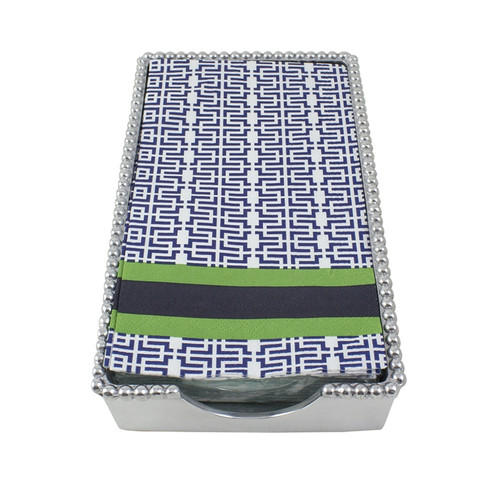 A Beaded Guest Towel Box is accented with chic Jacki print guest towels. Print combines a navy blue mosaic pattern with kelly green and navy stripes. Paper guest towels come with 16 triple-ply napkins per package. Recycled Sandcast Aluminum DETAILS & PRODUCT CARE Dimensions: 9in L x 5in W x 1.5in H Product Care: Our fine metal is handcrafted from 100% recycled aluminum. All items are food-safe and will not tarnish. Handwash in warm water with mild soap and towel dry immediately. Do not place in dishwasher or microwave. Avoid extended contact with water, salty or acidic foods; coat lightly with vegetable oil or spray to easily avoid staining. Warm to 350 degerees for hot foods. Freeze or chill for summer entertaining. Cutting directly on the metal surface will scratch the finish. Occasional use of non-abrasive metal polish will revive luster.