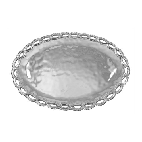 Delicate, openwork dances around the borders of textured serving pieces and gifts in our Filigree collection. The Oval Server adds style and grace to any table. Pair with the Filigree Sauce Dish to serve appetizers and dip. Recycled Sandcast Aluminum DETAILS & PRODUCT CARE Dimensions: 14.5in L x 10.25in W Product Care: Our fine metal is handcrafted from 100% recycled aluminum. All items are food-safe and will not tarnish. Handwash in warm water with mild soap and towel dry immediately. Do not place in dishwasher or microwave. Avoid extended contact with water, salty or acidic foods; coat lightly with vegetable oil or spray to easily avoid staining. Warm to 350 degerees for hot foods. Freeze or chill for summer entertaining. Cutting directly on the metal surface will scratch the finish. Occasional use of non-abrasive metal polish will revive luster.