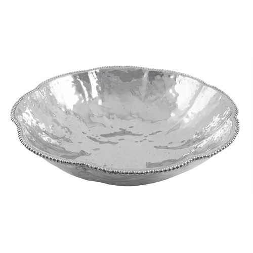 Serve up Sueño romance and reverie with this textured, delicately beaded Serving Bowl. Complement this elegant and simple bowl with the chic Sueño Interlaced Salad Servers. Handcrafted from 100% recycled sandcast aluminum. Recycled Sandcast Aluminum DETAILS & PRODUCT CARE Dimensions: 3.25in H Product Care: Our fine metal is handcrafted from 100% recycled aluminum. All items are food-safe and will not tarnish. Handwash in warm water with mild soap and towel dry immediately. Do not place in dishwasher or microwave. Avoid extended contact with water, salty or acidic foods; coat lightly with vegetable oil or spray to easily avoid staining. Warm to 350 degerees for hot foods. Freeze or chill for summer entertaining. Cutting directly on the metal surface will scratch the finish. Occasional use of non-abrasive metal polish will revive luster.