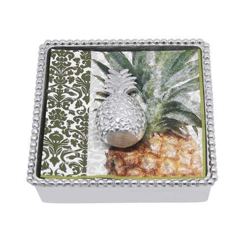 Mariposa Pineapple Beaded Naplin Box 1360-C 5.75in L x 5.75in W x 1.75in H  A magical symbol of hospitality, our sculpted, sandcast 3D Pineapple Napkin Weight sits atop a grove of elegant napkins and is paired with our Beaded Napkin Box. This makes a lovely hostess gift! Recycled Sandcast Aluminum