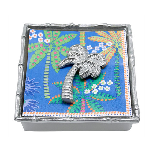 Mariposa Palm Tree Bamboo Napkin Box  1505-C 5.75in L x 1.5in W x 5.75in H  A vibrant palm tree decorates the cocktail napkins paired with a handcrafted Palm Tree Napkin Weight and Bamboo Napkin Box. Recycled Sandcast Aluminum
