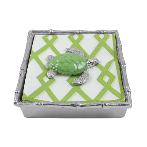 This box combines a set of green and white trellis, cocktail napkins; a sculpted Sea Turtle Weight in green; and a Bamboo Napkin Box. Recycled Sandcast Aluminum DETAILS & PRODUCT CARE Dimensions: 5.75in L x 5.75in W x 1.5in H Product Care: Handwash in warm water with mild soap and towel dry immediately. Do not place in dishwasher or microwave. Do not warm in oven or chill in freezer. Cutting directly on the surface may scratch the finish.