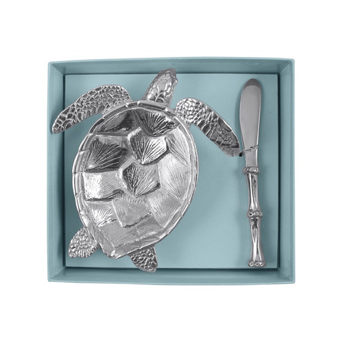 The Turtle Dish is paired with a Bamboo Spreader and packaged in a signature Mariposa gift box. Tie a ribbon around the box and present to your favorite hostess. Recycled Sandcast Aluminum DETAILS & PRODUCT CARE Dimensions: 7.5in L x 6.5in W x 2in H Product Care: Our fine metal is handcrafted from 100% recycled aluminum. All items are food-safe and will not tarnish. Handwash in warm water with mild soap and towel dry immediately. Do not place in dishwasher or microwave. Avoid extended contact with water, salty or acidic foods; coat lightly with vegetable oil or spray to easily avoid staining. Warm to 350 degerees for hot foods. Freeze or chill for summer entertaining. Cutting directly on the metal surface will scratch the finish. Occasional use of non-abrasive metal polish will revive luster.