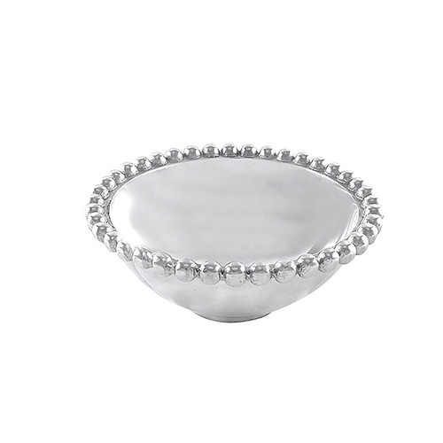 The Pearled Individual Bowl is a miniature version of our Pearled Serving Bowl for an individual helping of classic elegance. Part of our signature String of Pearls collection. Recycled Sandcast Aluminum DETAILS & PRODUCT CARE Dimensions: 2.25in H Product Care: Our fine metal is handcrafted from 100% recycled aluminum. All items are food-safe and will not tarnish. Handwash in warm water with mild soap and towel dry immediately. Do not place in dishwasher or microwave. Avoid extended contact with water, salty or acidic foods; coat lightly with vegetable oil or spray to easily avoid staining. Warm to 350 degerees for hot foods. Freeze or chill for summer entertaining. Cutting directly on the metal surface will scratch the finish. Occasional use of non-abrasive metal polish will revive luster.