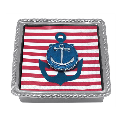 This Twist Napkin Box epitomizes preppy, nautical chic! A blue enamel Anchor Emblem Weight tops a stack of bold red and white anchor napkins. Recycled Sandcast Aluminum DETAILS & PRODUCT CARE Dimensions: 5.75in L x 5.75in W x 1.5in H Product Care: Handwash in warm water with mild soap and towel dry immediately. Do not place in dishwasher or microwave. Do not warm in oven or chill in freezer. Cutting directly on the surface may scratch the finish.