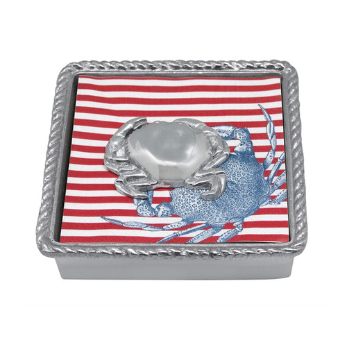 Mariposa Crab Rope Napkin Box  2640-C 5.75in L x 5.75in W x 1.5in H  Set out at your next seafood boil and smile at the delighted response you receive. Cocktail napkins feature a beautiful watercolor design of a blue crab. Napkins rest in a nautical twist bordered Napkin Box and are topped with a Crab Napkin Weight. Recycled Sandcast Aluminum