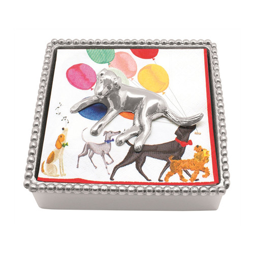 Sitting with legs outstretched, a Labrador Napkin Weight, in sandcast aluminum weighs down matching dog print napkins in our signature Beaded Napkin Box. Recycled Sandcast Aluminum DETAILS & PRODUCT CARE Item Code: 2747-C Dimensions: 5.75in L x 5.75in W x 1.5in H Product Care: Our fine metal is handcrafted from 100% recycled aluminum. All items are food-safe and will not tarnish. Handwash in warm water with mild soap and towel dry immediately. Do not place in dishwasher or microwave. Avoid extended contact with water, salty or acidic foods; coat lightly with vegetable oil or spray to easily avoid staining. Warm to 350 degerees for hot foods. Freeze or chill for summer entertaining. Cutting directly on the metal surface will scratch the finish. Occasional use of non-abrasive metal polish will revive luster.