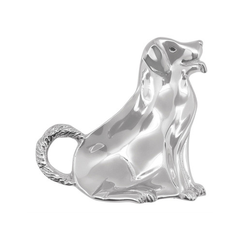 Meet Max, everyones favorite Labrador turned Trinket Dish. Playfully showcase candies and nuts, or small knickknacks. Handsomely handcrafted from 100% recycled aluminum. Recycled Sandcast Aluminum DETAILS & PRODUCT CARE Dimensions: 6.5in L x 6.5in W x 1.65in H Product Care: Our fine metal is handcrafted from 100% recycled aluminum. All items are food-safe and will not tarnish. Handwash in warm water with mild soap and towel dry immediately. Do not place in dishwasher or microwave. Avoid extended contact with water, salty or acidic foods; coat lightly with vegetable oil or spray to easily avoid staining. Warm to 350 degerees for hot foods. Freeze or chill for summer entertaining. Cutting directly on the metal surface will scratch the finish. Occasional use of non-abrasive metal polish will revive luster.