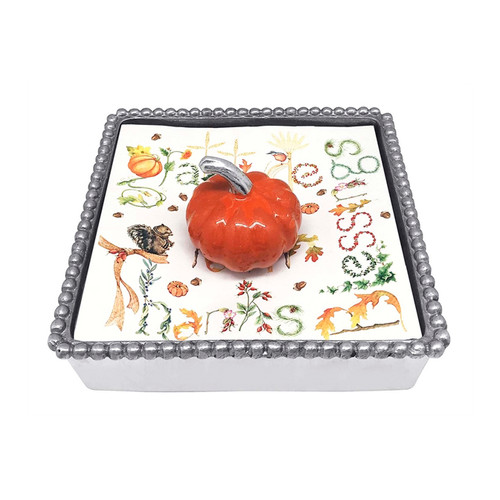 Mariposa Orange Pumpkin Beaded Napkin Box 1285-C 5.75in L x 5.75in W x 1.5in H  Add an autumnal and colorful touch with our Orange Pumpkin Beaded Napkin Box. A brilliant orange and plump Pumpkin Napkin Weight sits atop a seasonal stack of harvest napkins.  Recycled Sandcast Aluminum