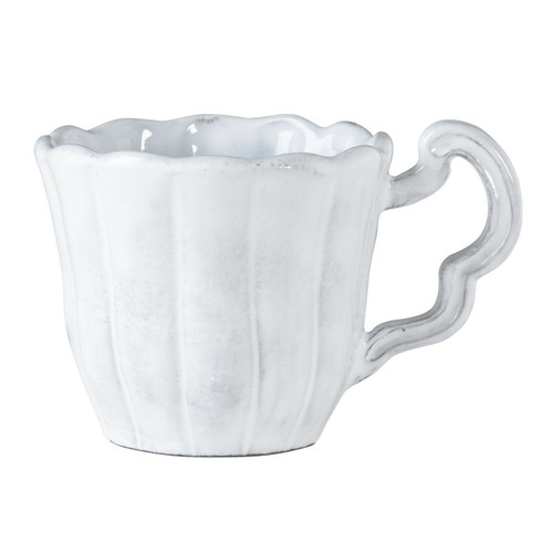 """The Incanto White Scallop Mug is inspired by the waves of the Adriatic; mix and match it with other settings for your own unique setting. 3.75""""D, 10 oz INC-1110K"""
