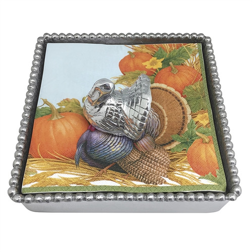 This set includes a festive Turkey Napkin Weight, turkey cocktail napkins, and a classic Beaded Napkin Box. Adds a whimsical touch to your Thanksgiving tablescape. Handcrafted from 100% recycled aluminum. Recycled Sandcast Aluminum