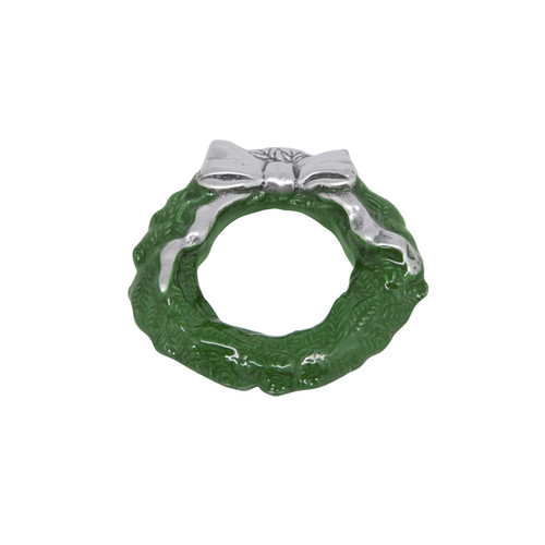 A festive and classic Green Wreath Napkin Weight is adorned with a silver bow. Handcrafted from 100% recycled aluminum. Recycled Sandcast Aluminum DETAILS & PRODUCT CARE Dimensions: 3in L x 3in W Product Care: Handwash in warm water with mild soap and towel dry immediately. Do not place in dishwasher or microwave. Do not warm in oven or chill in freezer. Cutting directly on the surface may scratch the finish.