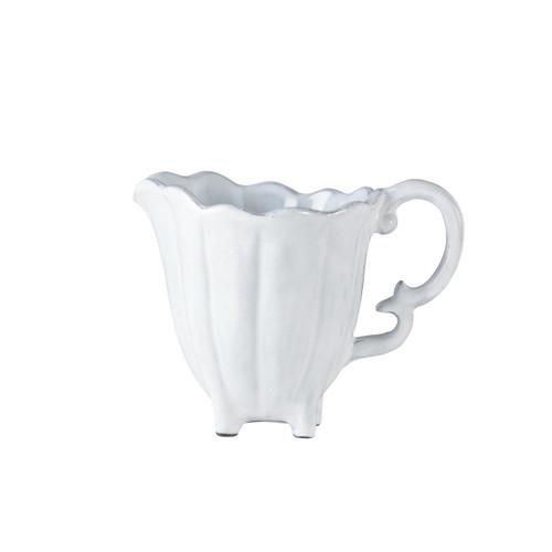 """The Incanto White Scallop Creamer is inspired by Italian history and is a charming addition to your table. 4.5""""H, 11 oz INC-1113"""