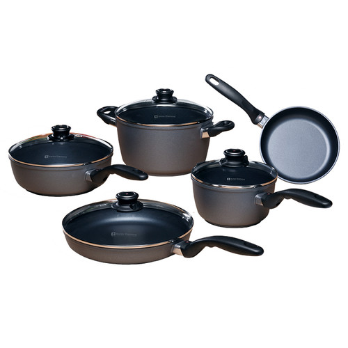 Kitchen Essentials 9 Piece Set  Inspired by the great European chefs, Swiss Diamond began making professional cookware over 10 years ago. Constructed of cast aluminum to maximize heating efficiency and eliminate hot spots. Designed to last a lifetime, Swiss Diamond's patented diamond-reinforced nonstick coating makes every dinner party memorable and cleaning a pleasure. The Swiss Diamond 9-Piece Set has everything you need to stock a complete kitchen:  8 inch Fry Pan (20 cm) 10.25 inch Fry Pan with lid (26 cm) 2.2-quart Saucepan with lid 3.2-quart Saute Pan with lid 5.5-quart Soup Pot with lid Guarantee a lifetime of healthy cooking with Swiss Diamond's Non-Stick Cookware. Whether you're a serious gourmet, a regular entertainer, or cooking for the family, this deluxe cookware set has versatile pieces for infinite menu options and great results!  Item #: SD609