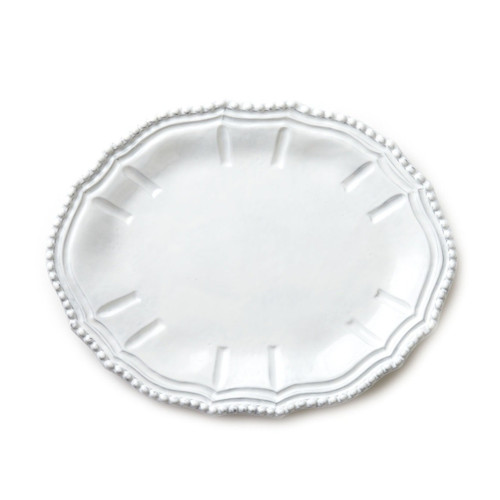 "The Incanto Baroque White Small Oval Platter features designs inspired by Italian architecture. A beautiful piece in addition to an existing Incanto collection or on its own, this platter complements every entertaining style. 13""L, 10""W INC-1124C"