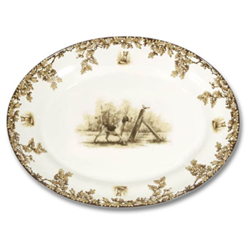 "C.E. Corey Aiken Hound Large Oval Platter  This timeless pattern was inspired by the fox hunting scene of Aiken, South Carolina and is ideal for casual or formal dining as it features beautifully detailed hunt scene with oak leaves and acorns. Microwave and dishwasher safe.  Every piece in the Aiken Collection is available with either the Fox or the Hound.  18.25""L, 14""W, 2.5""H  CEA-7056H"
