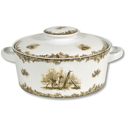 """C.E. Corey Aiken Hound Covered Casserole  This timeless pattern was inspired by the fox hunting scene of Aiken, South Carolina and is ideal for casual or formal dining as it features beautifully detailed hunt scene with oak leaves and acorns. Microwave and dishwasher safe.  Every piece in the Aiken Collection is available with either the Fox or the Hound.  9"""" Diameter, 6""""H, Dish is 3.5"""" H  CEA-7052H"""