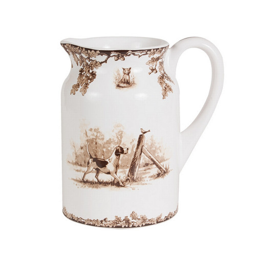 "C.E. Corey Aiken Hound Pitcher  This timeless pattern was inspired by the fox hunting scene of Aiken, South Carolina and is ideal for casual or formal dining as it features beautifully detailed hunt scene with oak leaves and acorns. Microwave and dishwasher safe.  Every piece in the Aiken Collection is available with either the Fox or the Hound.  8""H, 5""Diameter  CEA-7051H"