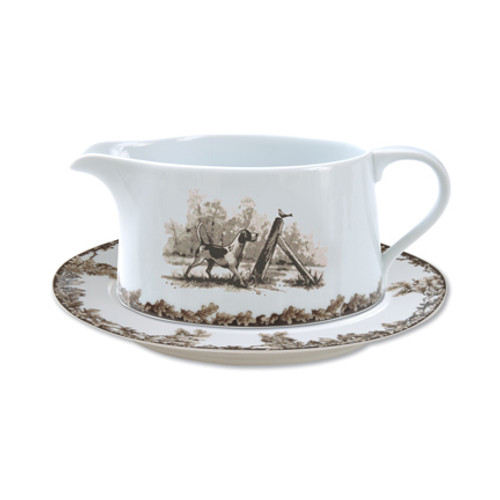 """C.E. Corey Aiken Hound Gravy Boat with Saucer  This timeless pattern was inspired by the fox hunting scene of Aiken, South Carolina and is ideal for casual or formal dining as it features beautifully detailed hunt scene with oak leaves and acorns. Microwave and dishwasher safe.  Every piece in the Aiken Collection is available with either the Fox or the Hound.  7.25""""L, 4""""W, 3""""H with 8"""" x 6.5"""" Saucer  CEA-7050H"""