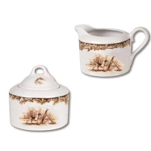 "C.E. Corey Aiken Hound Sugar & Creamer Set  This timeless pattern was inspired by the fox hunting scene of Aiken, South Carolina and is ideal for casual or formal dining as it features beautifully detailed hunt scene with oak leaves and acorns. Microwave and dishwasher safe.  Every piece in the Aiken Collection is available with either the Fox or the Hound.  Creamer:  4.5"" Diameter, 2.75""H   Sugar:  5"" Diameter, 3.75""H  CEA-7047H"