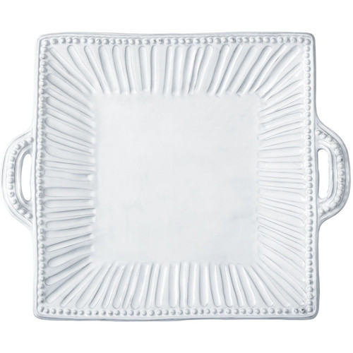 "Our most popular bridal gift, the Incanto White Stripe Square Handled Platter is a VIETRI classic. Incanto was inspired by the maestro artisan's family dinnerware heirlooms of many generations and the art and architecture of Italy. 16.75""L, 14""W INC-1128"