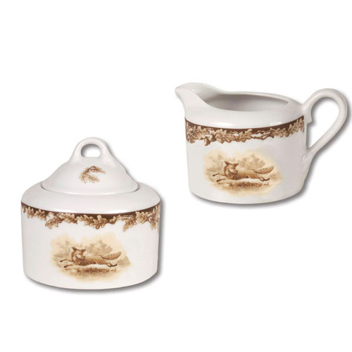 "C.E. Corey Aiken Fox Sugar & Creamer Set  This timeless pattern was inspired by the fox hunting scene of Aiken, South Carolina and is ideal for casual or formal dining as it features beautifully detailed hunt scene with oak leaves and acorns. Microwave and dishwasher safe.  Every piece in the Aiken Collection is available with either the Fox or the Hound.  Creamer:  4.5"" Diameter, 2.75""H   Sugar:  5"" Diameter, 3.75""H  CEA-7047F"