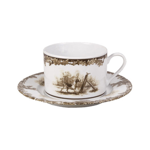 "C.E. Corey Aiken Hound 11oz Cup & Saucer  This timeless pattern was inspired by the fox hunting scene of Aiken, South Carolina and is ideal for casual or formal dining as it features beautifully detailed hunt scene with oak leaves and acorns. Microwave and dishwasher safe.  Every piece in the Aiken Collection is available with either the Fox or the Hound.  11oz cup, 6.5"" Saucer  CEA-4037H"