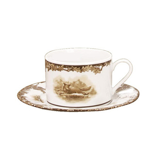 """C.E. Corey Aiken Fox 11oz Cup & Saucer  This timeless pattern was inspired by the fox hunting scene of Aiken, South Carolina and is ideal for casual or formal dining as it features beautifully detailed hunt scene with oak leaves and acorns. Microwave and dishwasher safe.  Every piece in the Aiken Collection is available with either the Fox or the Hound.  11oz cup, 6.5"""" Saucer  CEA-4037F"""