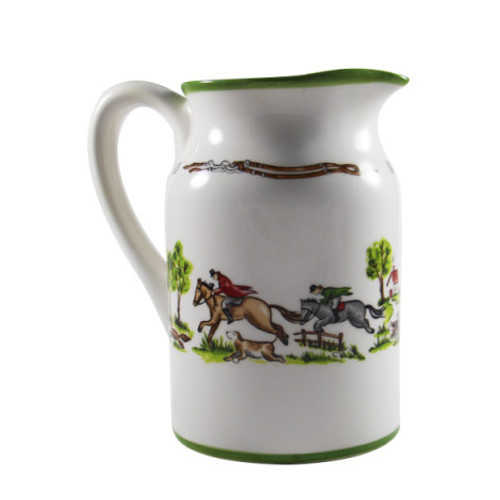 """C.E. Corey The Chase Pitcher  The Chase Pitcher is ideal for serving your favorite beverages in style. This high-fired porcelain piece is perfect for both casual and fine dining. It's hand-decorated with delightfully-quaint images of riders, hounds and a foxhunt.   CTC4005 7.5""""H, 5"""" Diameter"""
