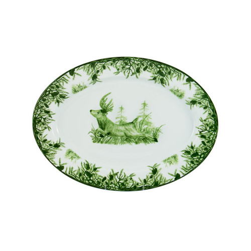 """C.E. Corey Forest Medium Oval Platter  Perfect for casual or upscale dining, this high-fired, handmade porcelain collection features a forest scene of a proud buck standing tall amidst pine-cones in tones of green and will bring to life any table setting.  CEF-4019 15""""L, 14""""w"""