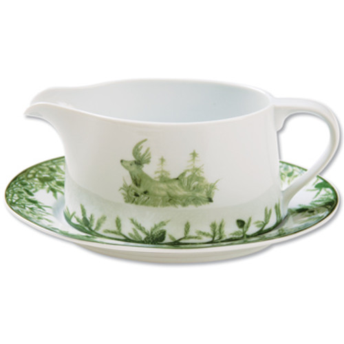 """C.E. Corey Forest Gravy Boat Set  Perfect for casual or upscale dining, this high-fired, handmade porcelain collection features a forest scene of a proud buck standing tall amidst pine-cones in tones of green and will bring to life any table setting.  CEF-4013  7.25"""" long, 4"""" wide, 3"""" tall and rests on a 8""""x6.5"""" dish."""