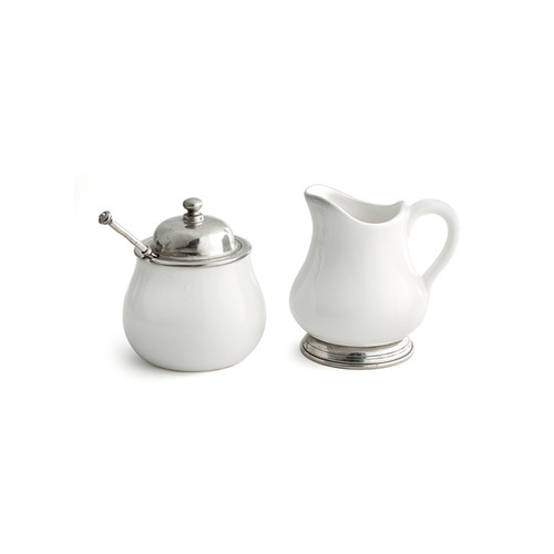 """Arte Italica Tuscan Sugar & Creamer Set The original pewter and ceramic dinnerware, combines white ceramic with our signature pewter trim. Handcrafted of the highest quality materials, this classic sugar and creamer set translates seamlessly from traditional to contemporary, from casual to formal. Italian ceramic and pewter, Hand made in Italy.  Hand wash only.  Dimensions: S: 3.5"""" D x 4"""" H, C: 4"""" L x 3.75"""" W x 4"""" H, 9 oz"""