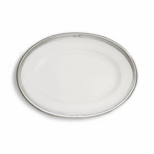 "The original pewter and ceramic dinnerware, combines white ceramic with our signature pewter trim. Handcrafted of the highest quality materials, this classic platter translates seamlessly from traditional to contemporary, from casual to formal. Italian ceramic and pewter, Hand made in Italy.  Hand wash only.  Dimensions: 14 1/2"" X 10 1/2"" SKU: P5167"