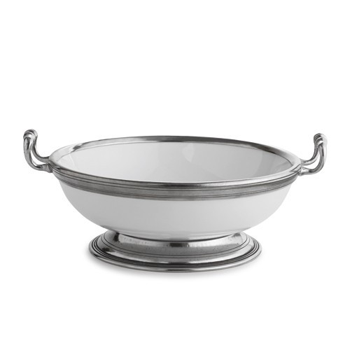 "The original pewter and ceramic dinnerware, combines white ceramic with our signature pewter trim. Handcrafted of the highest quality materials, this classic bowl translates seamlessly from traditional to contemporary, from casual to formal. Italian ceramic and pewter, Hand made in Italy.  Hand wash only.  Dimensions: 10"" D X 4"" H SKU: P5106B"