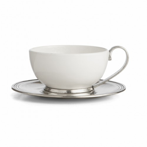 "The original pewter and ceramic dinnerware, combines white ceramic with our signature pewter trim. Handcrafted of the highest quality materials, this classic cup and saucer translates seamlessly from traditional to contemporary, from casual to formal. Italian ceramic and pewter, Hand made in Italy.  Dishwasher safe on the low-heat/air-dry setting, non-abrasive detergent recommended.  Dimensions: C:4.5"" D X 2.75"" H, S:6.5"" D SKU: P5116"