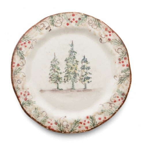 """Natale is the perfect collection to entertain through the winter season. Berries and pine boughs surround the snowy evergreens. Our Natale Plate is perfect for serving tasty treats, or cookies for Santa. Hand made in Italy.  Microwaveable (may get hot) and dishwasher safe on the low heat, air-dry setting.  Dimensions: 8.5"""" D SKU: NAT9122"""