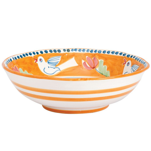 The colorful orange and blue Campagna Uccello Large Serving Bowl features whimsical handpainted birds and flowers. Mix with other animals from the Campagna collection to create a fun table that captures the vitality of the Italian countryside! UCC-1025