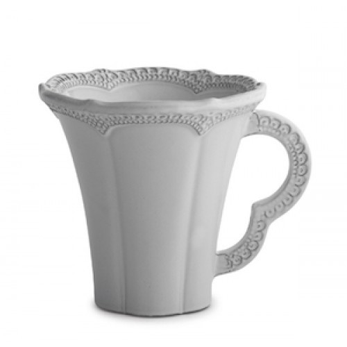 "A delicate white glaze, a rich, black clay and an vintage lace pattern blend beautifully to create this stunning mug. Italian ceramic, Hand made in Italy.  Microwavable, oven & dishwasher safe on the low-heat/air-dry setting.  Dimensions: 5"" H SKU: MER0279W"