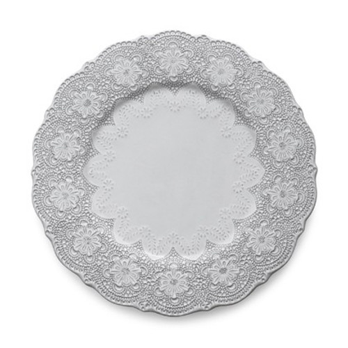 """A delicate white glaze, a rich, black clay and an vintage lace pattern blend beautifully to create this stunning plate. Italian ceramic, Hand made in Italy.  Microwavable, oven & dishwasher safe on the low-heat/air-dry setting.  Dimensions: 12.25"""" D SKU: MER1133W"""