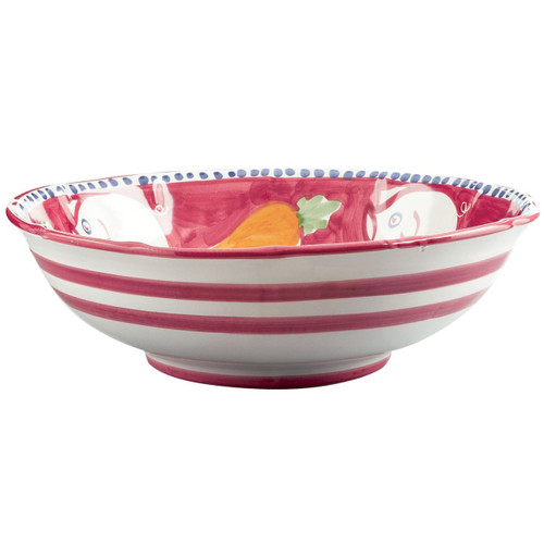 "The colorful Campagna Porco Large Serving Bowl features whimsical handpainted pigs and carrots on the inside with stripes on the outside. 12""D POR-1025N"
