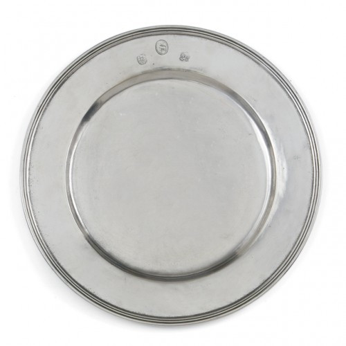 "Centuries-old technique and fine Italian pewter make a beautiful presentation. This charger moves from contemporary to traditional with ease. Italian pewter, Hand made in Italy.  Food safe, dishwasher safe on the low-heat/air-dry setting, non-abrasive detergent recommended.  Dimensions: 13"" D SKU: P2473"