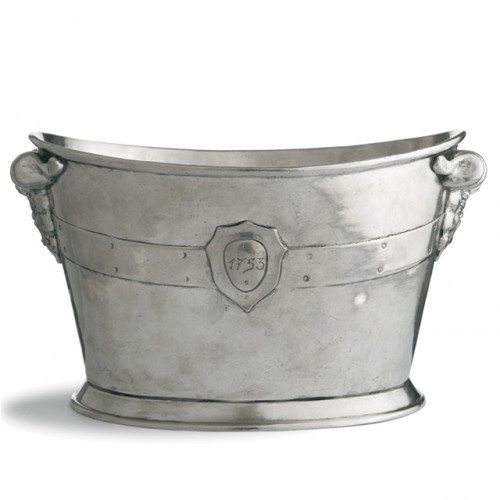 "The stately elegance of this ice bucket makes a distinguished addition to any setting. Italian pewter, Hand made in Italy.  Dishwasher safe on the low-heat/air-dry setting, non-abrasive detergent recommended.  Dimensions: 14.75"" L x 9"" W x 8.5"" H SKU: VIN0355"